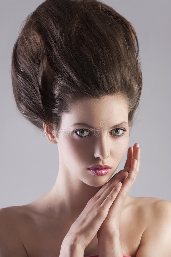 Brunette lady with creative hairdo royalty free stock photo