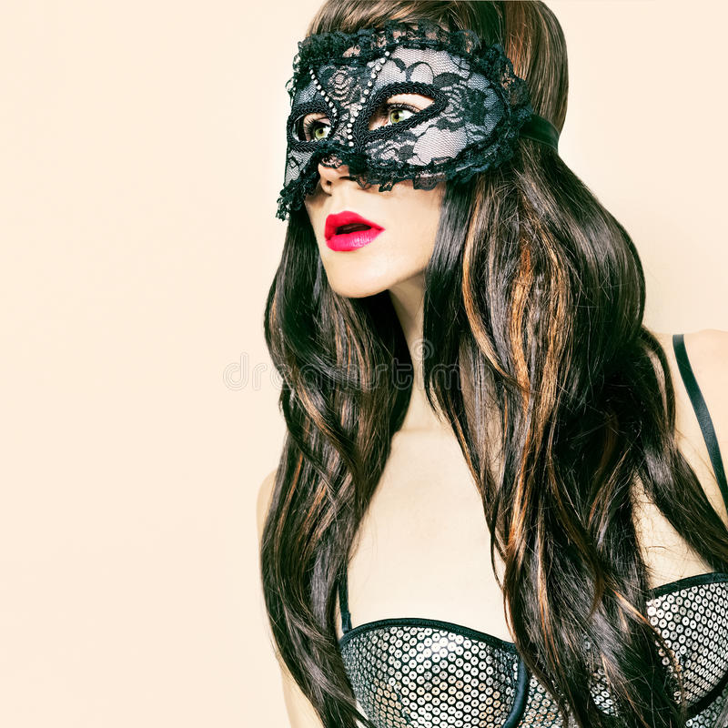 Brunette lady in fancy mask. carnival party. Sensual brunette lady in fancy mask. carnival party stock photos