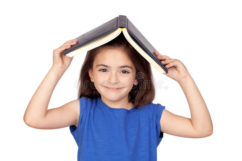 Brunette little girl with a book on her head royalty free stock images