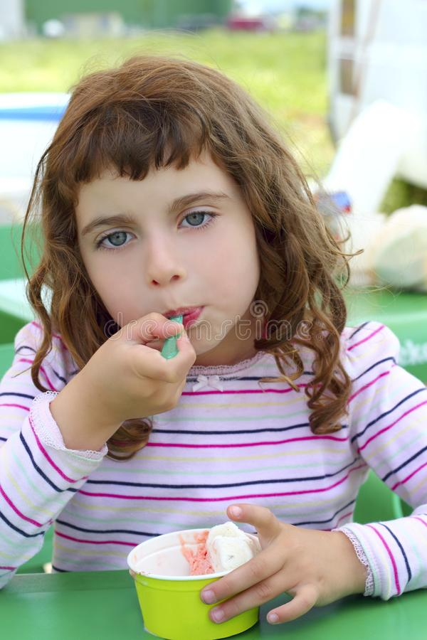 Download Brunette Little Girl Eating Ice Cream Stock Images - Image: 15431154