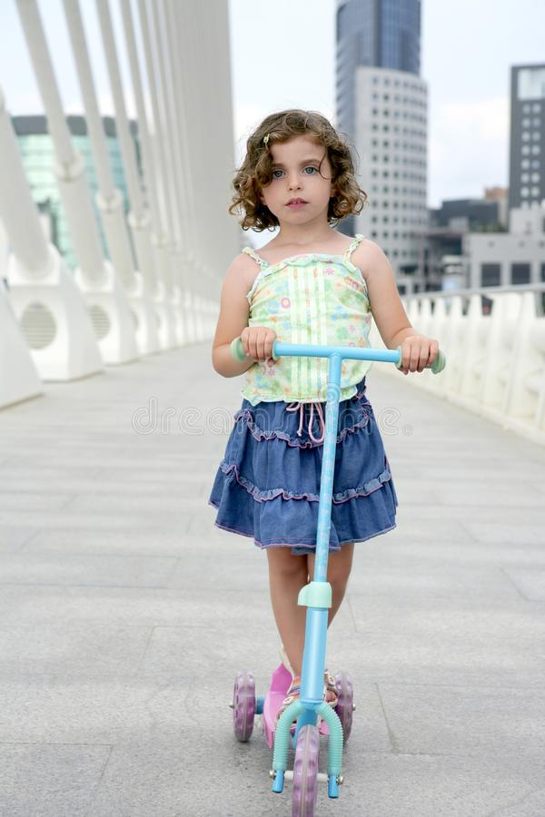 Download Brunette Little Girl With Scooter In The City Stock Photo - Image: 9912590