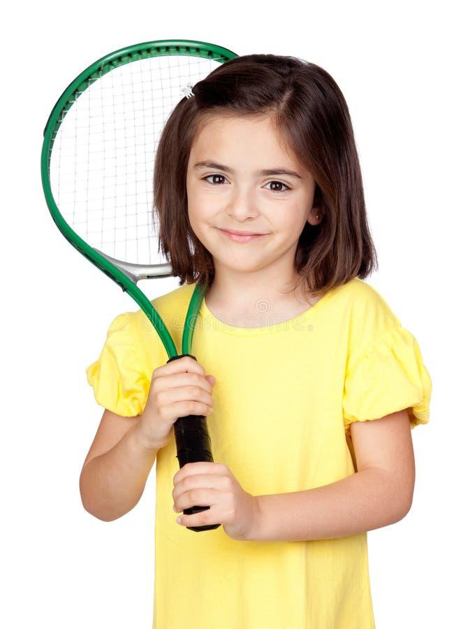 Brunette little girl with a tennis racket stock photos
