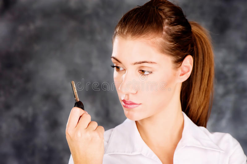 Brunette looking at a key royalty free stock photos