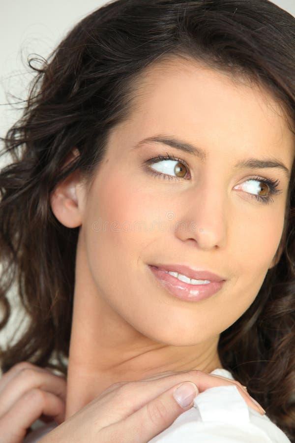 Brunette Looking Over Shoulder Stock Photography