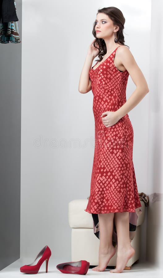 Download Brunette Looking At Red Dress Stock Image - Image of lady, female: 19548479