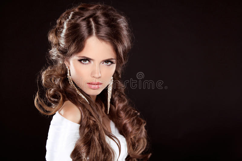 Brunette. Luxury Woman with Long Brown Curly Hair. Fashion Model royalty free stock image