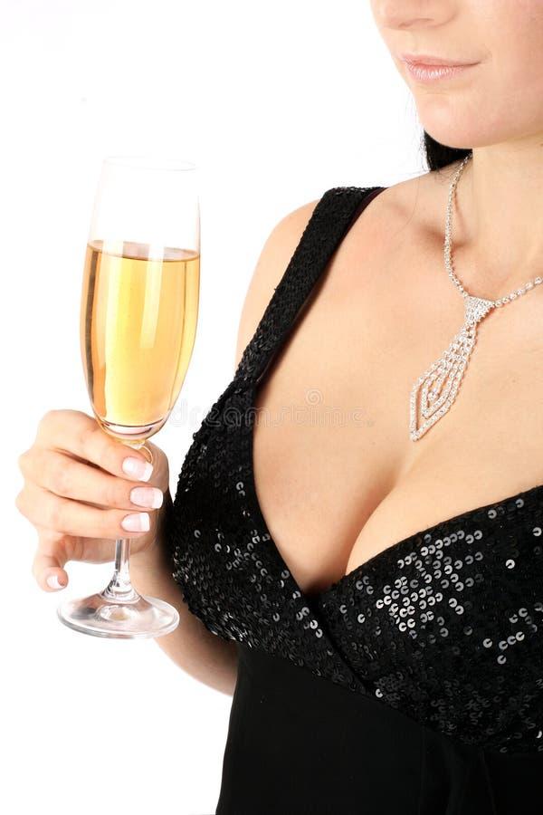 Brunette met een champagneglas. stock afbeeldingen