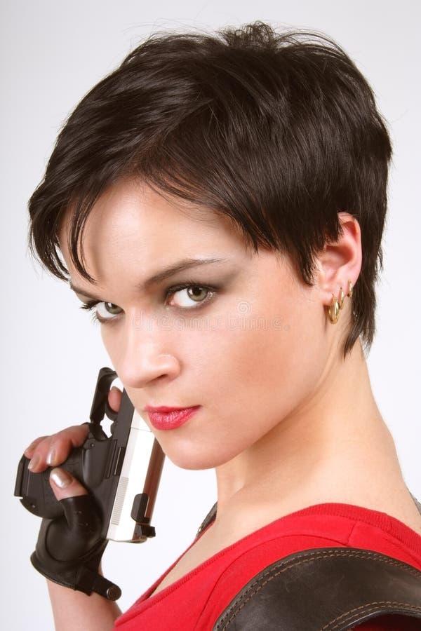 Brunette met pistool royalty-vrije stock foto's