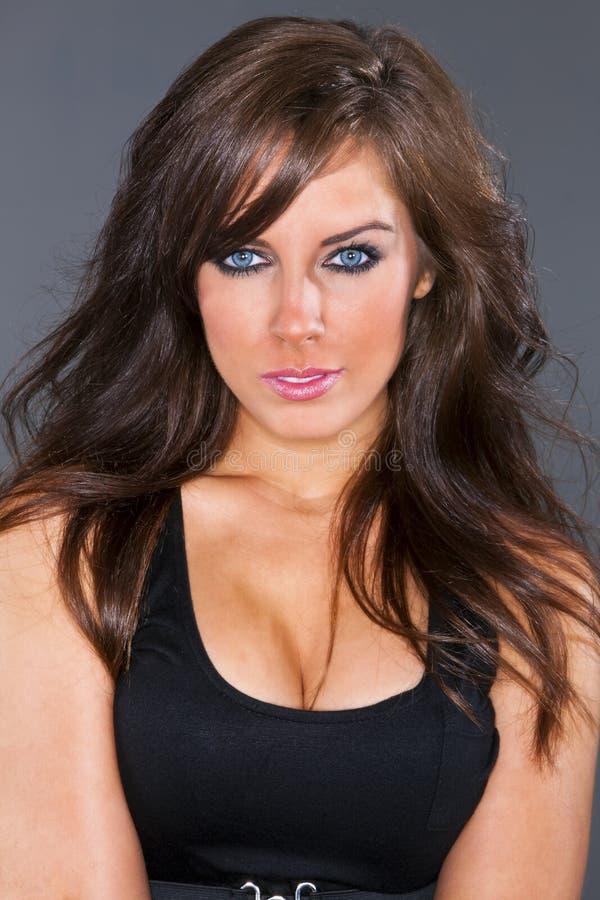 Beautiful Blue Eyed Brunette Model Posing In A Studio Environment stock photo