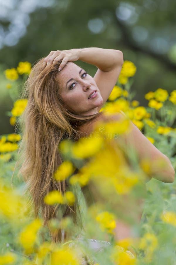 Brunette Model In A Field of Flowers royalty free stock photo