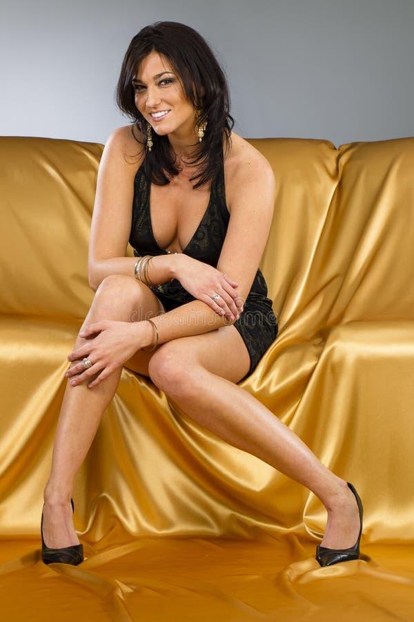 Brunette Model In A Gold Dress stock images