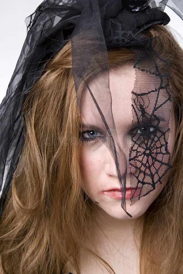 Brunette Model in Goth. Clothing over white background stock photo
