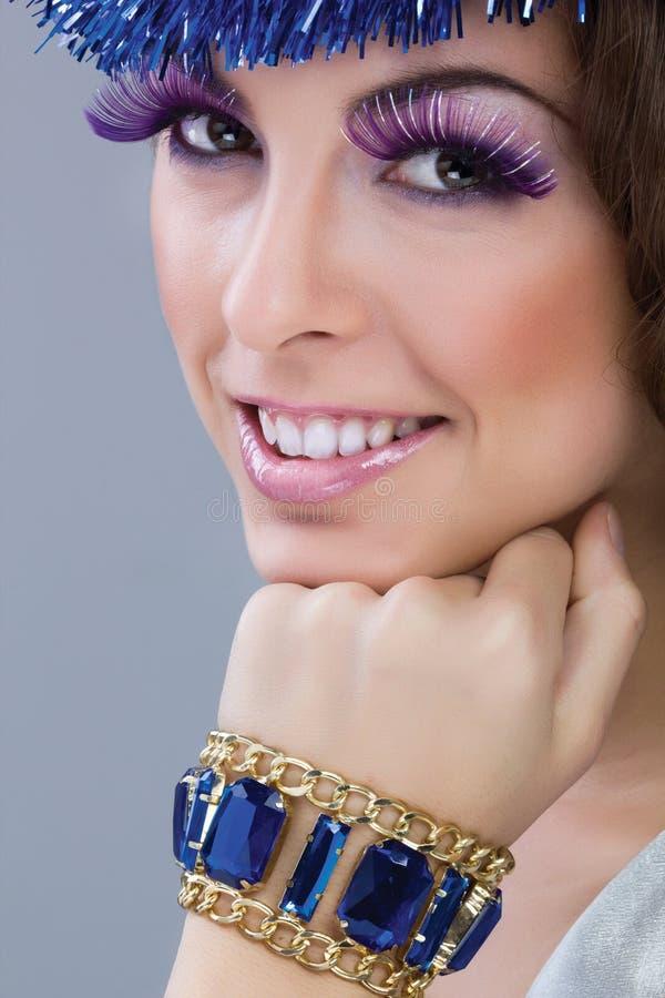 Brunette model portrait. make up, false eyelashes. Beautiful brunette model portrait,colorful make-up royalty free stock image