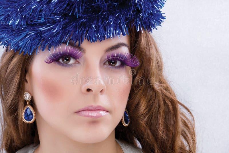 Brunette model portrait. make up, false eyelashes. Beautiful brunette model portrait,colorful make-up stock images