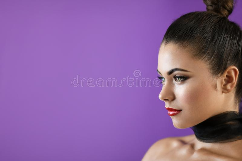 Brunette model with red lipstick on purple cover background stock images