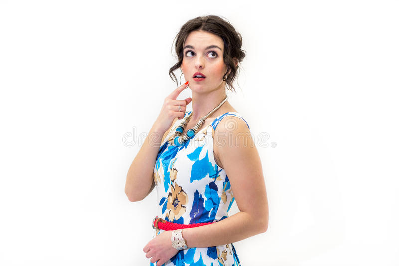 Brunette model standing looking up thinking. Brunette model standing looking up thinking, fashion and beauty royalty free stock photo