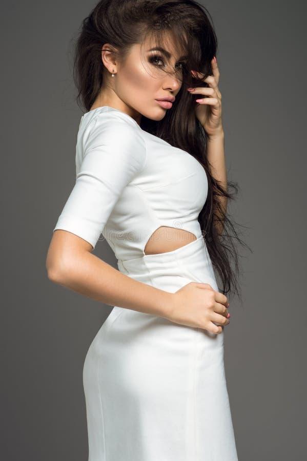 Brunette model touching hair royalty free stock photos