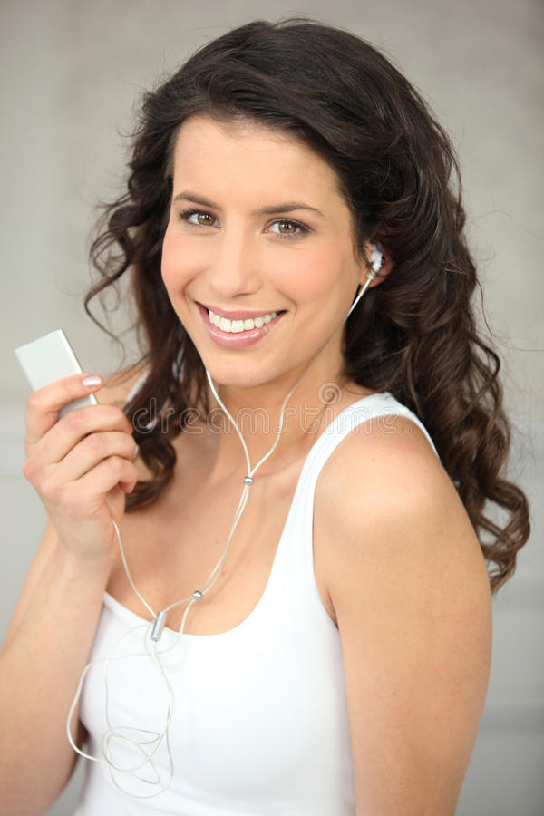 Brunette with music device stock images