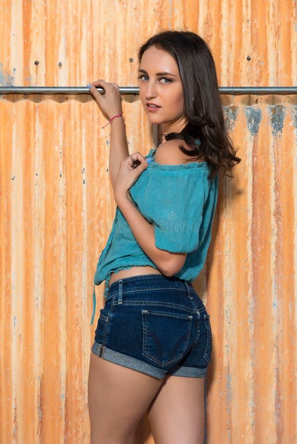 Brunette no azul fotografia de stock