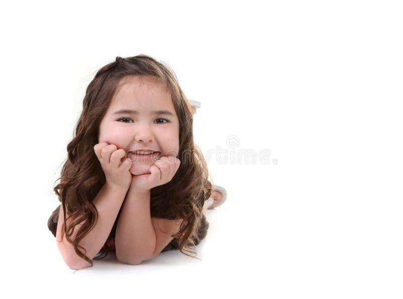 Brunette novo de sorriso da criança no fundo branco fotos de stock royalty free