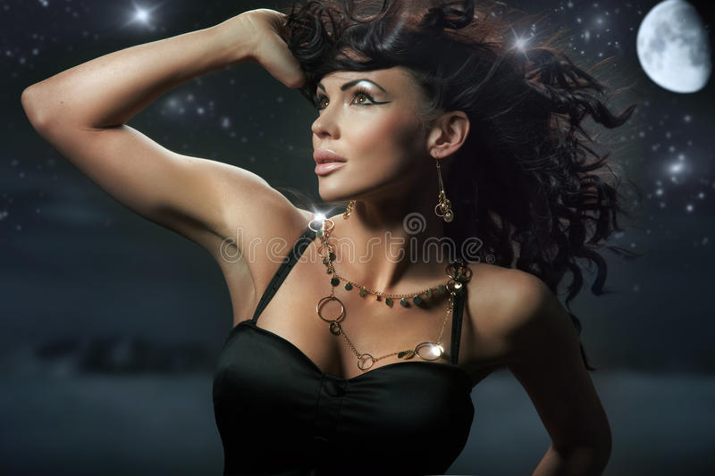 Brunette over starry night stock images