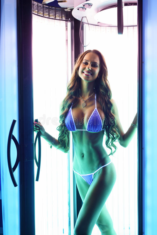 Brunette with perfect fit body posing in solarium. Nice brunette with perfect fit body posing in solarium stock photos