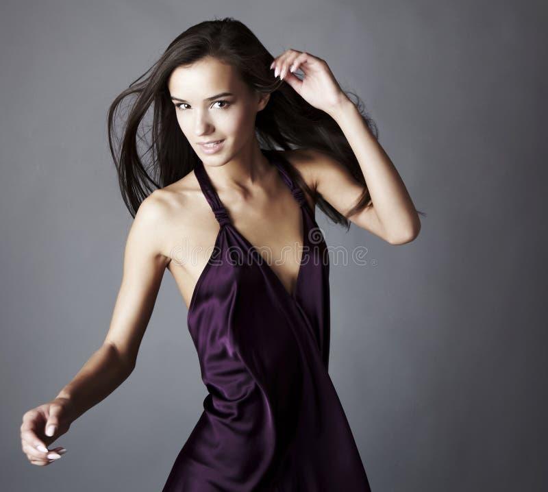 Free Brunette Posing In Silk Violet Dress Stock Photography - 16128072