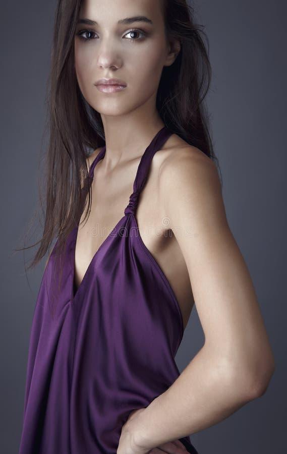 Free Brunette Posing In Silk Violet Dress Royalty Free Stock Images - 16128139