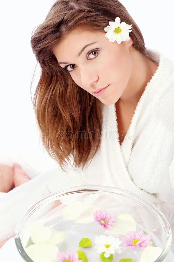 Brunette preparing for spa treatment stock images