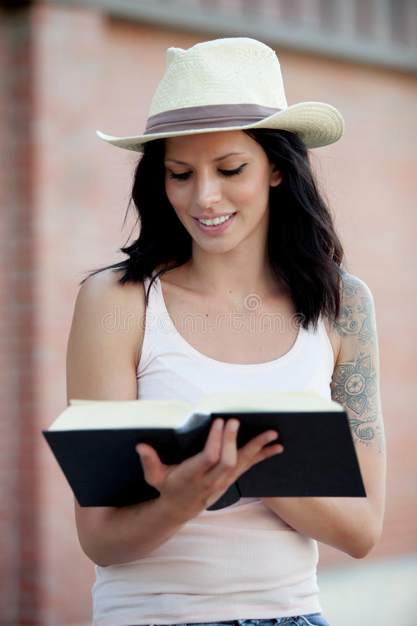 Brunette pretty woman reading a book royalty free stock photos