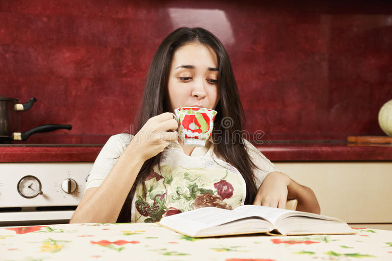 Brunette reading book stock photography