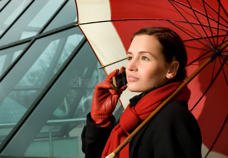 Download Brunette with red umbrella stock image. Image of call - 5174841