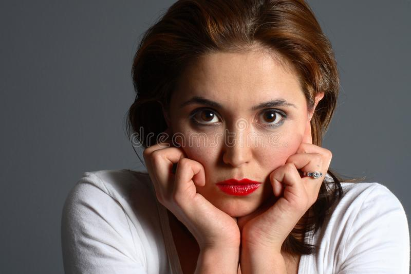 Download Brunette resting on hands stock image. Image of girl, thought - 1418713