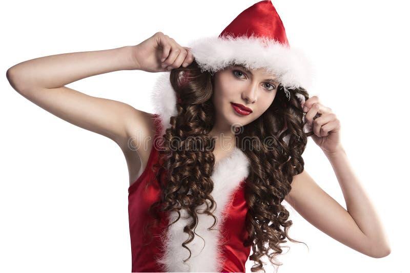 Brunette rizado vestido como Papá Noel imágenes de archivo libres de regalías