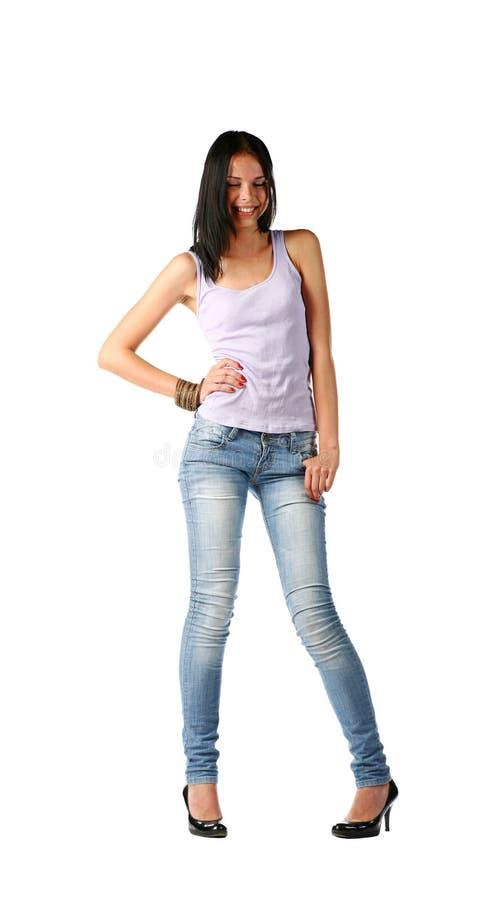 Brunette 'sexy' nas calças de brim imagens de stock royalty free