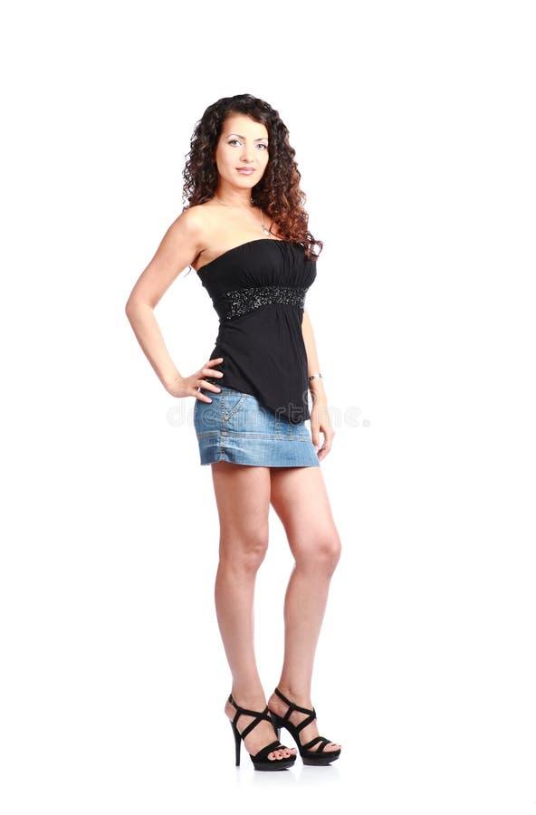 Brunette 'sexy' no desgaste das calças de brim fotografia de stock royalty free
