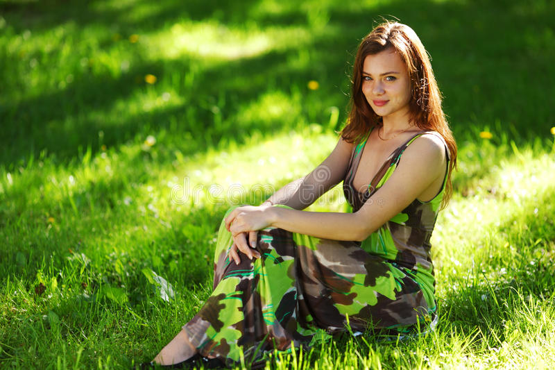 Download Brunette Sitting On Green Grass Stock Photos - Image: 29148383
