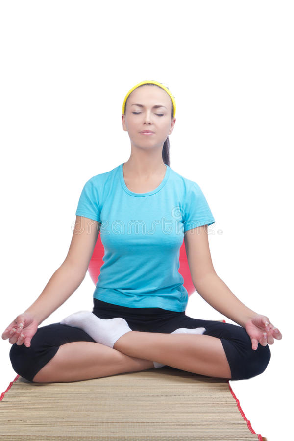 Download Brunette Sitting On Mat And Doing Yoga Exerci Stock Image - Image: 21186853