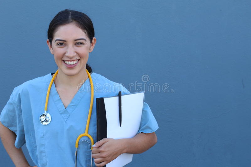 Brunette spanish doctor woman with a clipboard on blue background royalty free stock photo