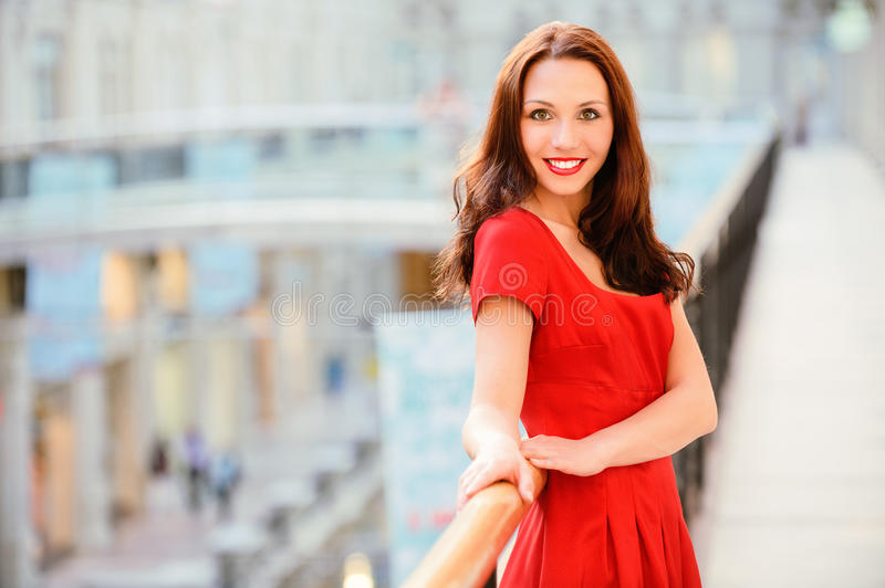Brunette Stands At Banister Royalty Free Stock Image