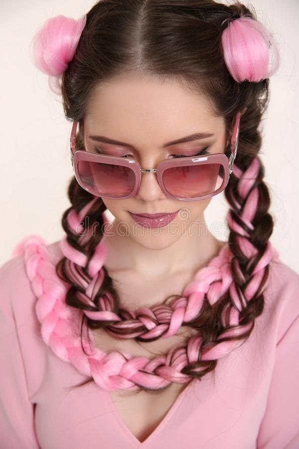 Brunette teen girl braided with two french braids from pink kane stock photography