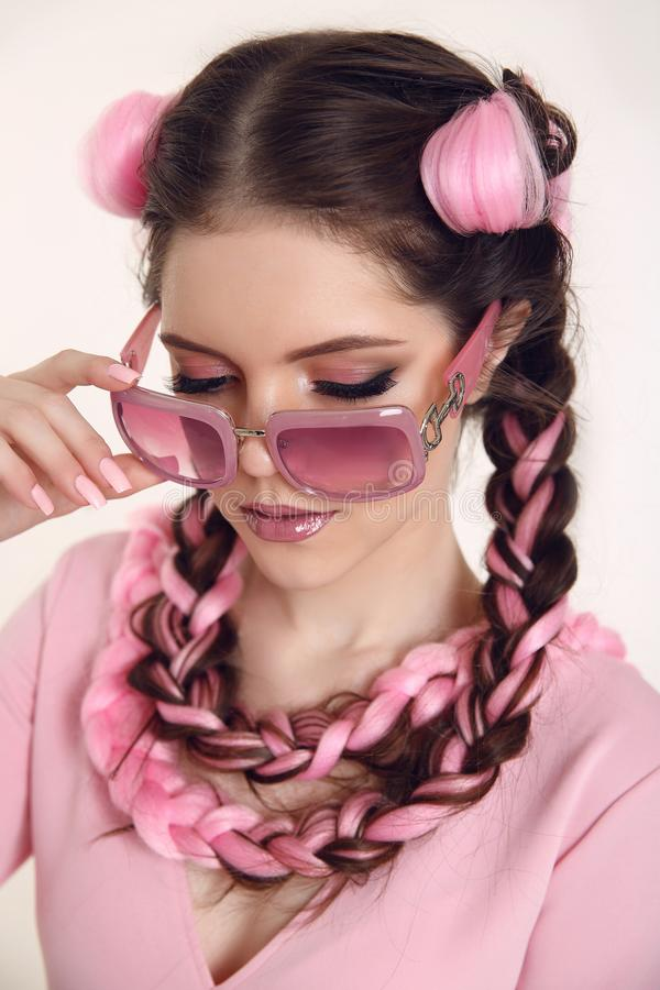 Brunette teen girl braided with two french braids from pink kane royalty free stock image