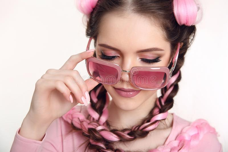 Brunette teen girl braided with two french braids from pink kane stock photo