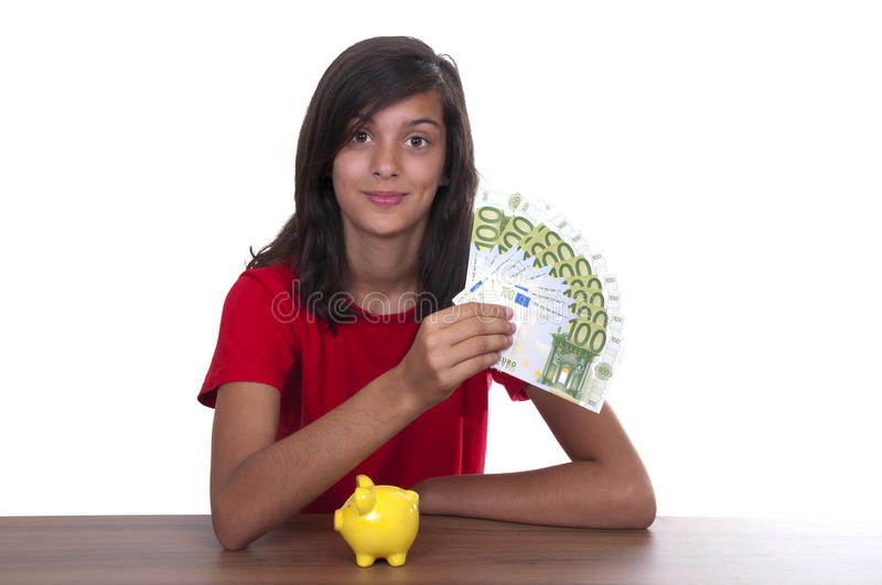 Brunette Teen Girl With Piggy Bank Royalty Free Stock Photo