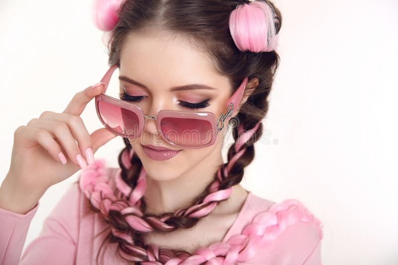 Brunette teen girl with two french braids from pink kanekalon, f royalty free stock image