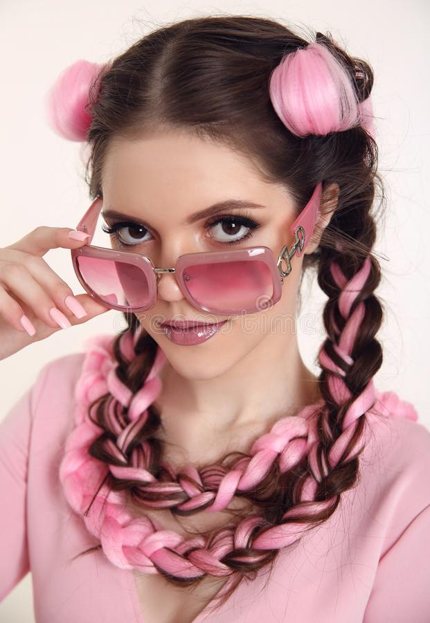 Brunette teen girl with two french braids from pink kanekalon, f royalty free stock photo