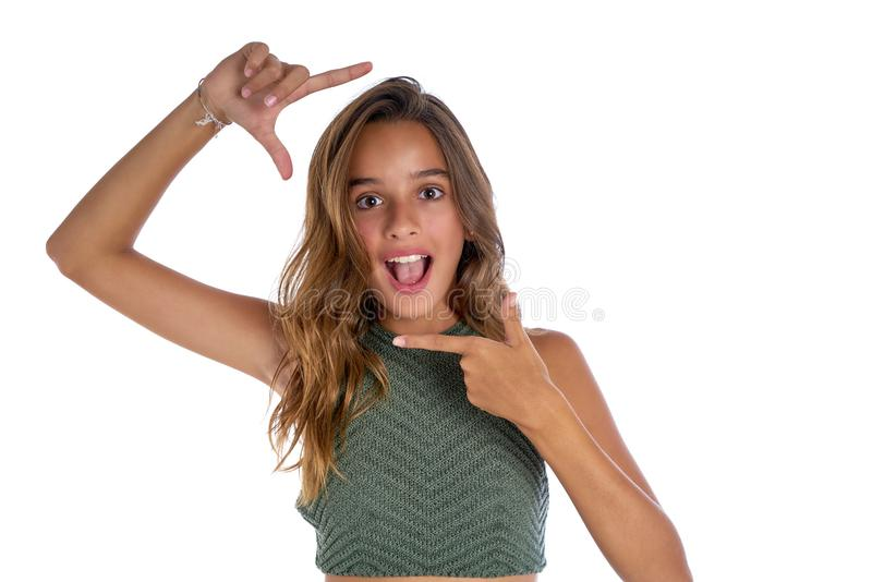 Brunette teenager girl frame fingers gesture royalty free stock image