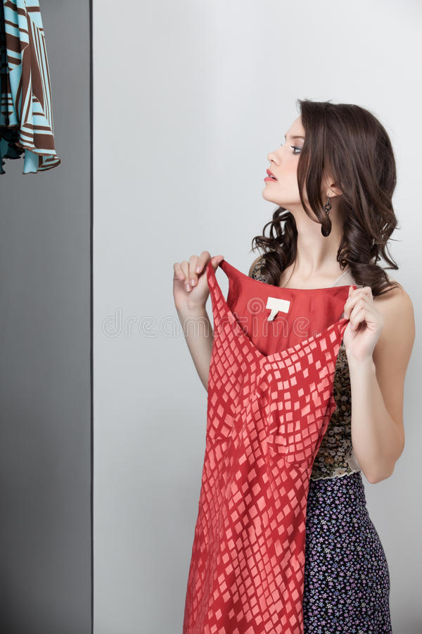 Download Brunette Trying On Red Dress Stock Image - Image: 19548429