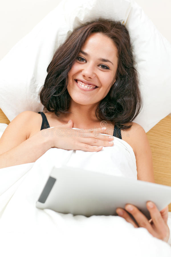 Download Brunette Using An Electronic Tablet Royalty Free Stock Photos - Image: 26959158