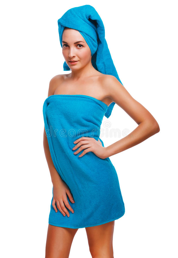 Brunette van het vrouwen het slanke dunne krullende meisje in blauwe handdoek na badsho royalty-vrije stock fotografie